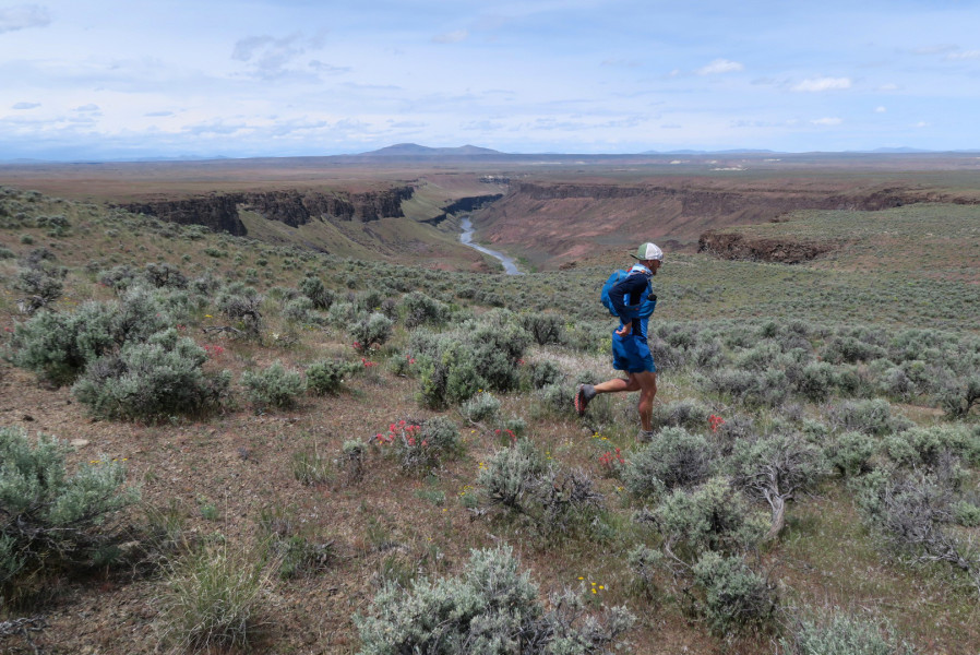 Jeff Browning running through the Owyhee Canyonlands.  Photo Credit:  Jesse Haynes